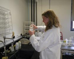 Student performing pH analysis