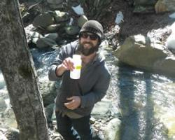 Volunteer sampling a stream