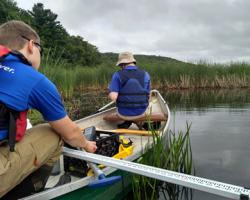 Sampling from canoe on the Blackstone River