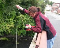 Dr. Paula Rees sampling the Blackstone River