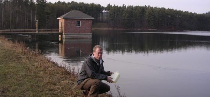 Dr. David Reckhow sampling water
